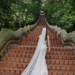 Walking Up The Steps Of The Chiang Mai Temple