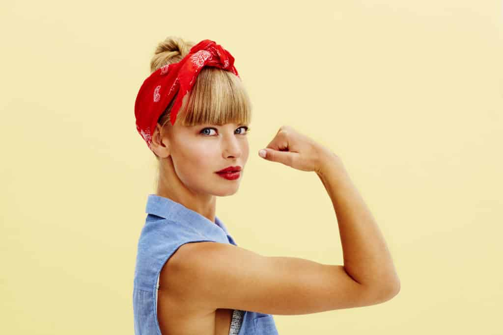 Strong Blond Woman Flexing Muscle