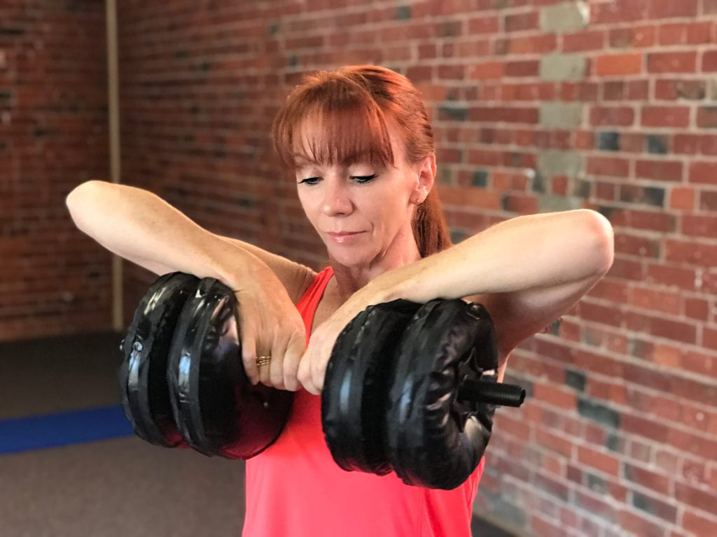 Courage To Travel Showing Upright Row With Water Dumbell Weights For Travelling Women