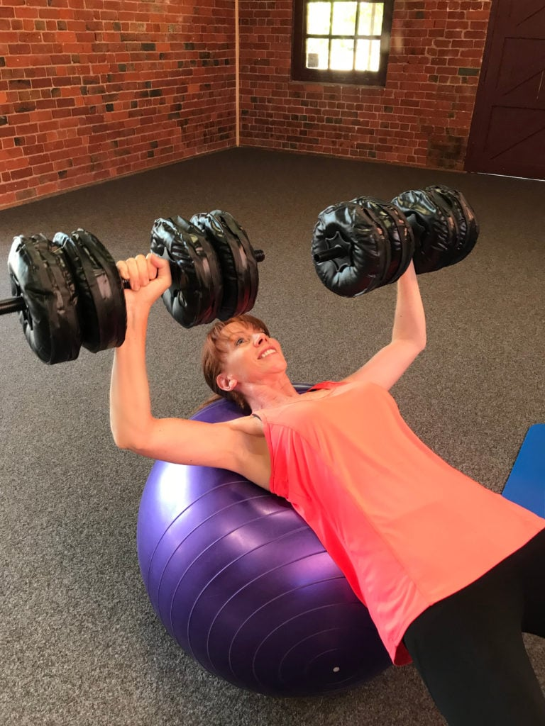 Tegan Marshall Demonstrates Travel Exercises With Water Weights When Travelling