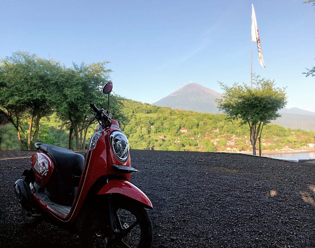 Scooter Traveling In Amed Bali With Mt Agung In Background For Courage To Travel Blog Post Scaled