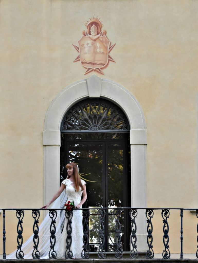 Tegan Marshall and the Wandering Wedding Dress at the entrance of the Karma Tuscany building