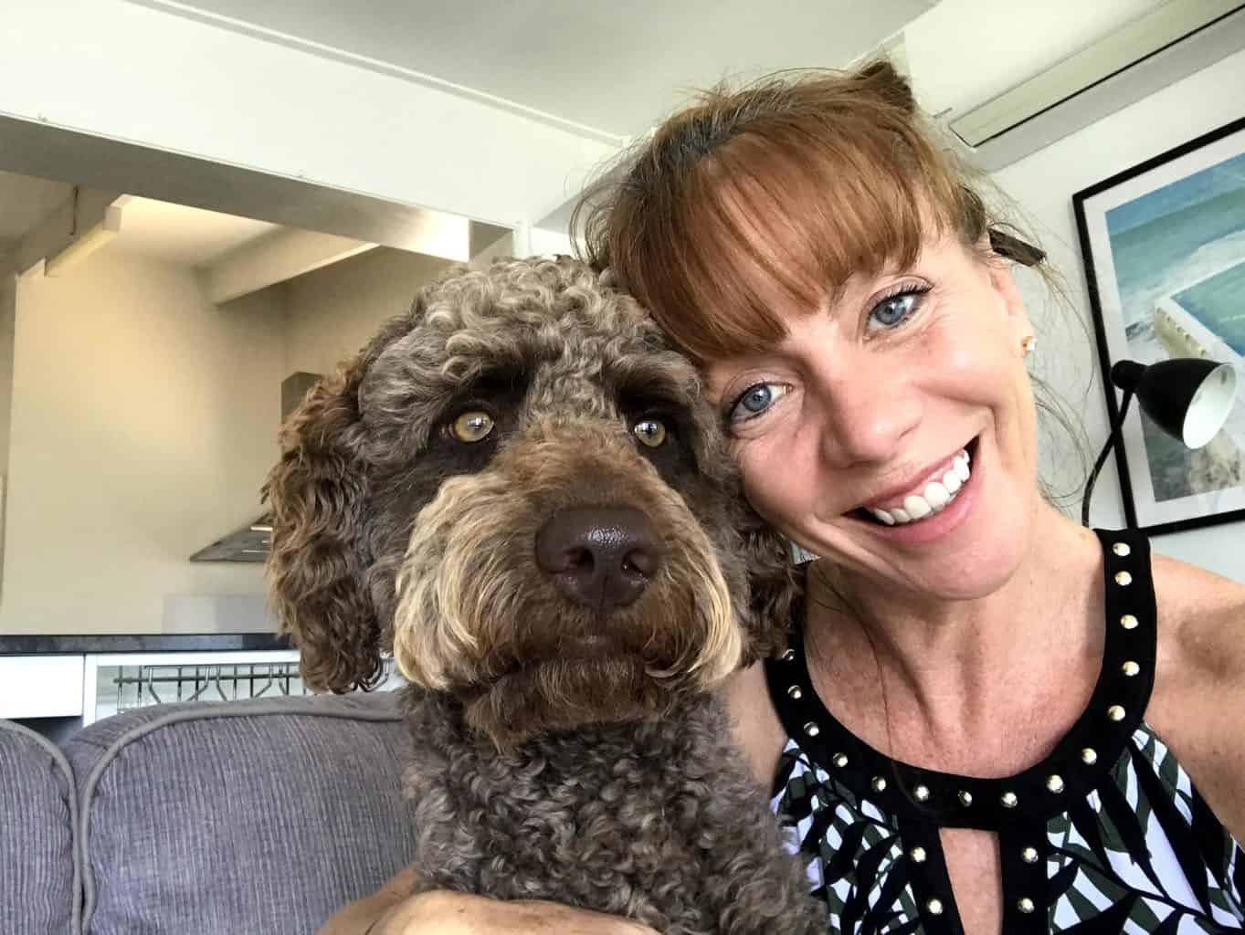 Tegan Marshall and Paddy the labradoodle